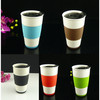 Porcelain single wall cup with silicone sleeve and plastic lid