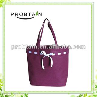 non woven promotional bag with a ribbon bow
