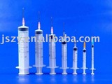 Disposable syringe with luer slip