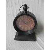 Antique metal clock with handle