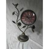 Delicate metal clock top with bird