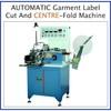 Garment label cutting and centre folding machine
