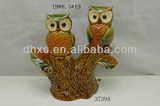 Owl candle holders on the tree