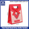 Yiwu Manufacturer professional production 4 colours offset printing white cardboard gift paper bags with Ribbon bow
