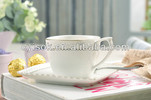 Relidf porcelain coffee cup and saucer set