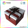 cake box with black ribbon closure